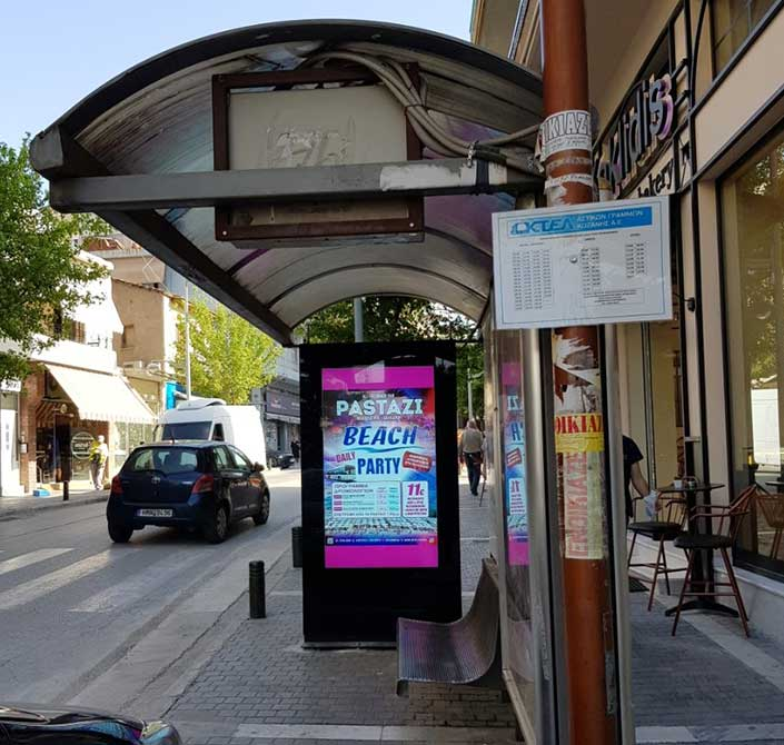 outdoor digital signage bus shelter display in Greece