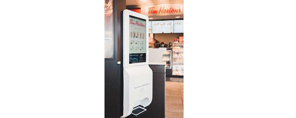 hand sanitizer digital signage in beverage shop in USA