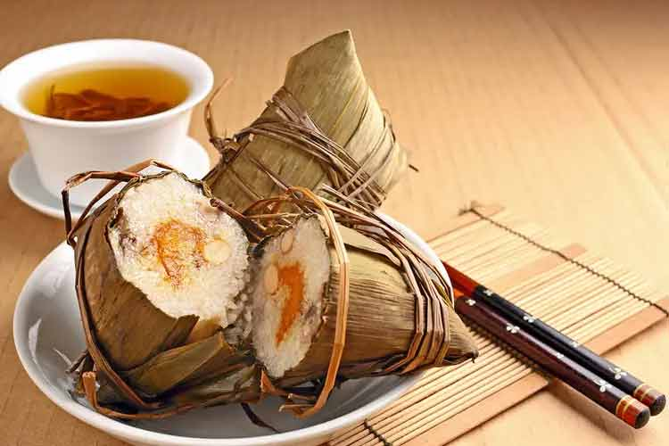 Eating Traditional Food Zongzi